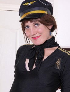 Passionate Redhead Katrina Mathews is Clothed Up As a Beautiful Airline Pilot