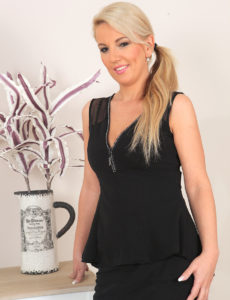 Blond Knockout Luci Gal Shows Her Little Black Petticoat and then Puts on Her Make-up Nude
