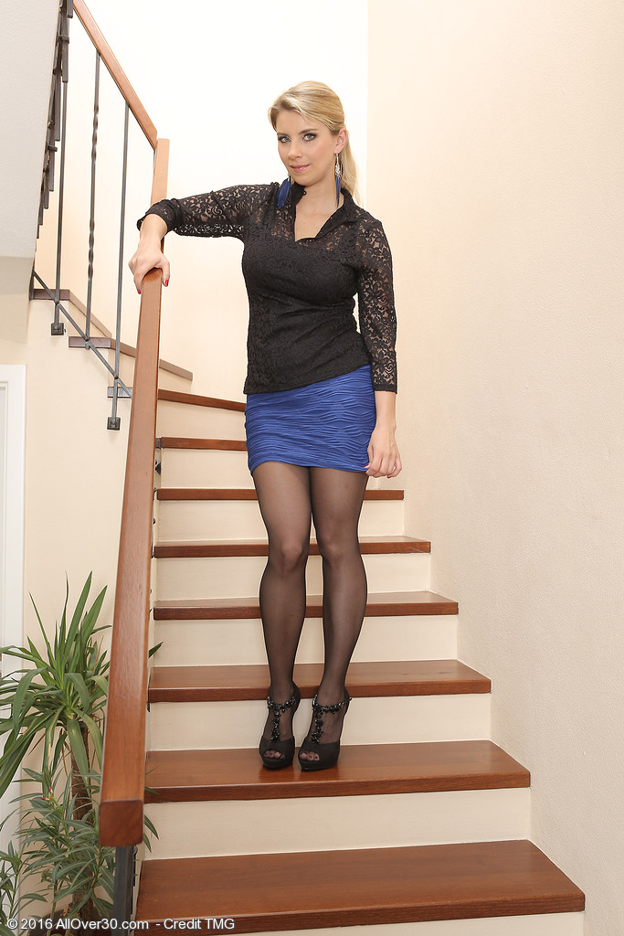 Buxomy Stunner Kathy Kozy Shows Those Large Boobs on the Stairs