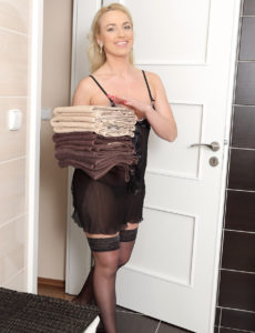 Blond Haired Playgirl Eve Valentine Puts Away Towels and Shows off